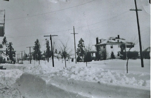 Winter 1936, looking north on NE 30th toward intersection with Mason.