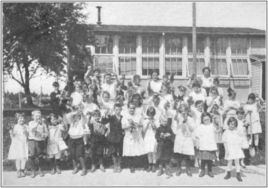 """First crop of radishes and lettuce at the Alameda Park School, Portland, Oregon, June, 1916. Even in the primary grades children may learn much about the science of growing things. Courtesy L.A. Alderman"""