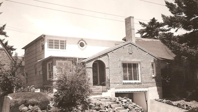 This home, located 3273 NE Fremont, seems to have a little of Birkemeier's old and new style. Note the oculus window above and the decorative brick face up front with the wide clapboard siding toward the rear of the house. The photo was taken about the time the house was built in March 1938. Photo courtesy of Dan Birkemeier.