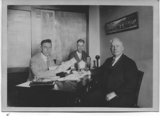 William Donahue in his later years, on the right, as an insurance agent for the American United Life Insurance Company.
